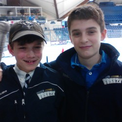 Brenden Gasaway (left) and Sean-Austin Soucy of the Maine Freeze Tier II Peewees hockey team during the New England District Regional at Alfond Arena in Orono, Maine, Sunday, March 10, 2013.