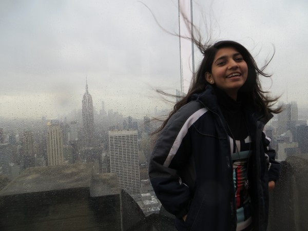 Aqsa Munir, an exchange student from Pakistan spending the year in Maine, made her first visit to New York City over winter break. She is standing on the observation deck on top of the Rockefeller Center building, with the Empire State Building in the background.