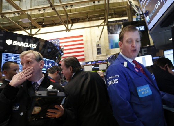 Traders work on the floor of the New York Stock Exchange March 5, 2013. The Dow surged to a new record on Tuesday, breaking through levels last seen in 2007 as investors extended 2013's rally.