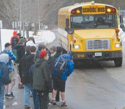 Wiscasset High School students head for the bus after classes recently.