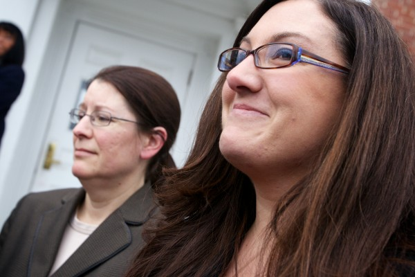 Kennebunk Police Officer Audra Presby (right) and York County Deputy District Justina McGettigan speak to reporters outside the York County Courthouse in Alfred on Wednesday, March 6, 2013, after a jury convicted Mark Strong on 12 counts of promoting prostitution and one count of conspiracy to promote prostitution.