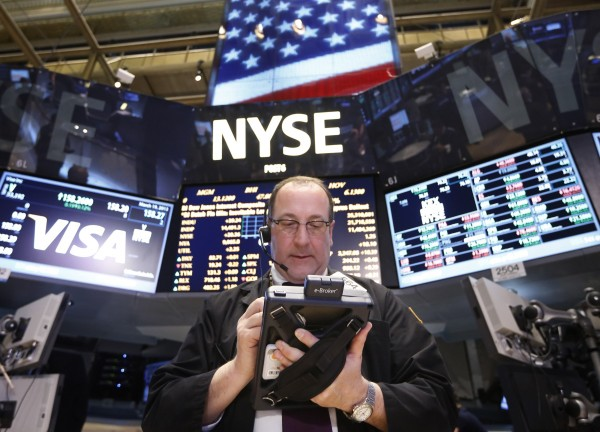 A trader works on the floor at the New York Stock Exchange, March 19, 2013.