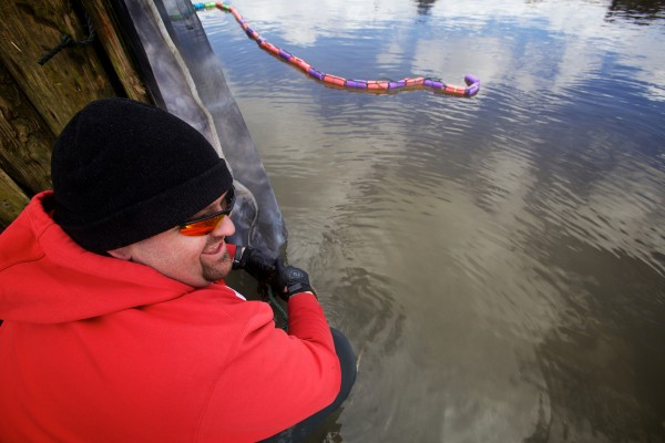 Awesus Mitchell prepares his elver fyke net at the Waldoboro town landing Friday. Mitchell won one of eight Penobscot Nation elver licenses issued this year in a lottery.