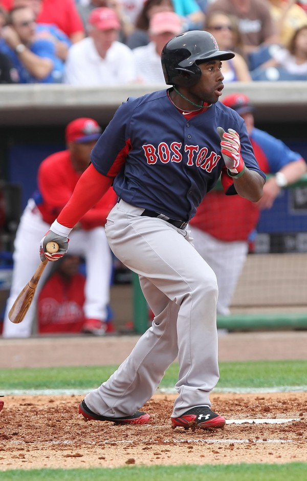 Boston's Jackie Bradley Jr. hits a sacrifice fly against the Philadelphia Phillies during Sunday's spring training game in Clearwater, Fla. Bradely, who had a .271 average for the Portland Sea Dogs a year ago in 61 games with six homers and 29 RBIs, is trying to earn a roster spot with the Red Sox.