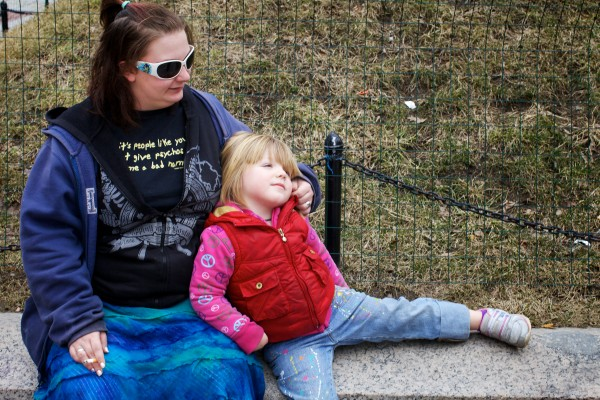 Desirae Rowe sits with daughter, Kasen Leeman, 3, in Portland's Monument Square on Wednesday, smoking a cigarette. Rowe says she's not worried about the city's ban on smoking in public places and the potential $50 fine.