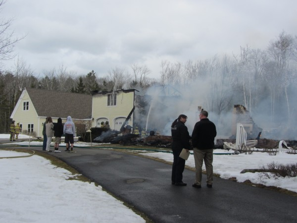 An investigator from the Maine Fire Marshal's Office was on the scene Tuesday afternoon of a fire that destroyed a home in Camden.