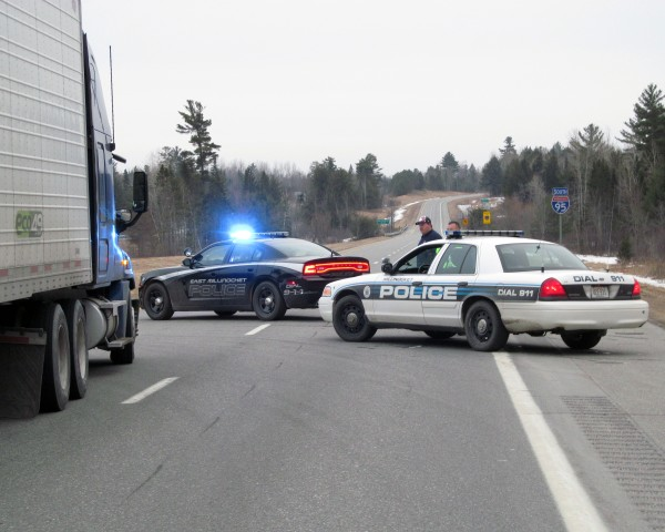 East Millinocket and Lincoln police maintain a road block just south of the I-95 southbound exit near Chester and Lincoln as police handle an apparent standoff along the highway farther south on Monday, March 11, 2013.