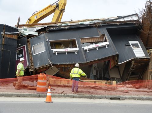 Demolition crews take down the building that once housed Graziano's Casa Mia restaurant, a landmark in Lisbon and in Maine's boxing community for the memorabilia displayed there for decades by the Graziano family. In its place will be a new restaurant.