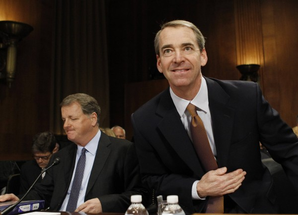 Douglas Parker (left), chairman and CEO of US Airways Group, sits as Thomas Horton, chairman and CEO of American Airlines and AMR Corp., gestures before the Senate Judiciary Committee in Washington March 19, 2013.