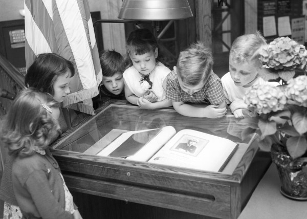 In 1955, a serious moment came into the lives of several children at Bangor Public Library as they looked at the Honor Book of the Bangor heroes who gave their lives in World War II.  (From left) Jaciel Bateman, Barbara Cormier, Richard King, Kathy-Jo Hunter, Philip and Richard Downes.