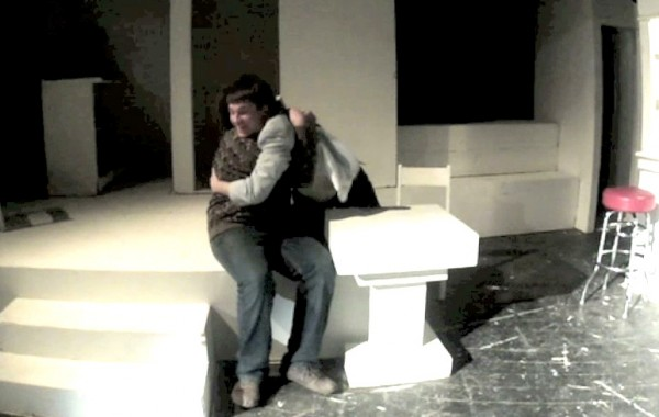 """Two members of the Fort Kent drama club embrace during a re-enactment of the club's winning one-act play """"Prelude to a Kiss."""""""