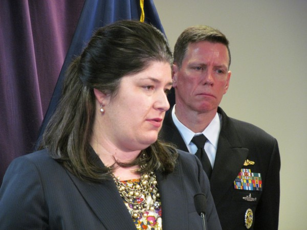 Assistant U.S. Attorney Darcie McElwee fields questions alongside U.S. Navy Rear Adm. Richard Breckenridge Friday in Portland. Casey James Fury, 25, was sentenced to 205 months in prison Friday for setting two fires at Portsmouth Naval Shipyard in Kittery last year.