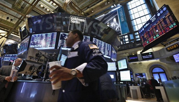 Traders work on the floor at the New York Stock Exchange, March 11, 2013.
