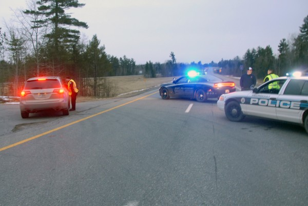 East Millinocket and Lincoln police maintain a road block just south of the Interstate 95 southbound exit in Mattamiscontis Township near Chester and Lincoln as police handle an apparent standoff along the highway farther south on Monday, March 11, 2013.