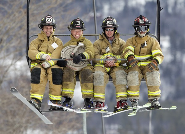 Hopkinton, Mass., firefighters (from left) Chris Boudette, Nate Martel, Don Delude, and Capt. Sean Weldon ride the chairlift before competing in the 23rd annual Firefighters Race. Seventeen teams from as far away as Connecticut competed at Sunday River Ski Resort, Sunday, March 24, 2013, in Newry.