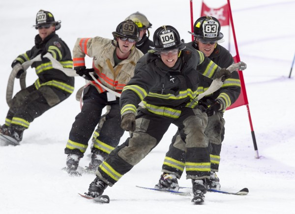 Tom Printup of the Auburn Fire Department, reaches for the finish line during the 23rd annual Firefighters Race at Sunday River Ski Resort, Sunday, March 24, 2013, in Newry.