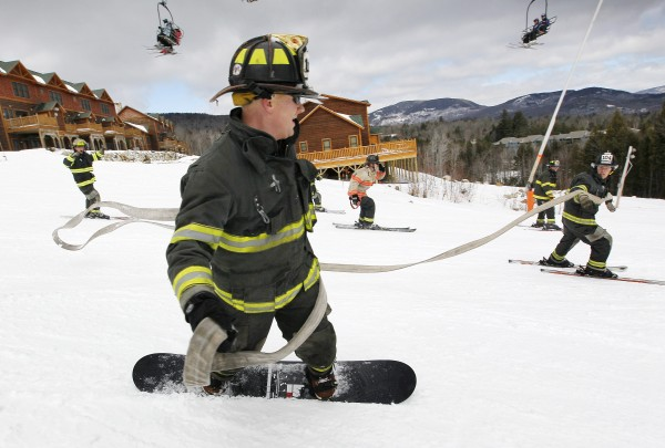 The team from Auburn crosses the finish line during the 23rd annual Firefighter's Race at the Sunday River Ski Resort, Sunday, March 24, 2013, in Newry.