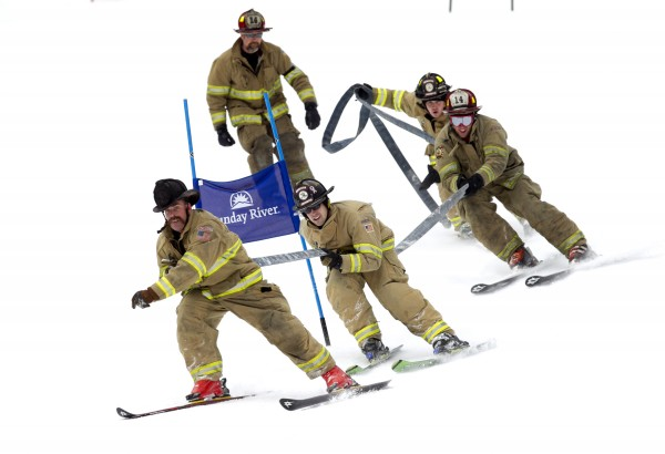 Steve Johnson leads the team from Rochester, N.H., around a gate in the Firefighters Race at the Sunday River Ski Resort, Sunday, March 24, 2013, in Newry.