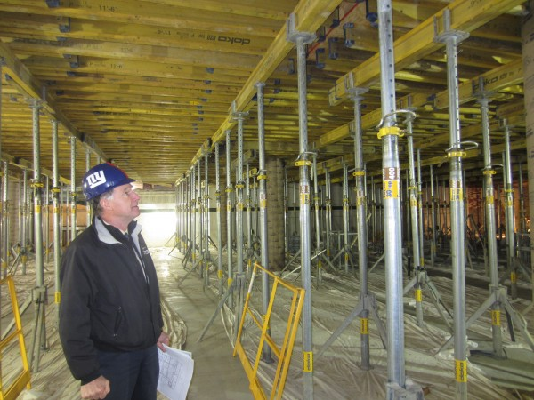 Don Borkowski, director of capital projects at Bowdoin College, examines steel supports in the first floor of the old gymnasium at the former Longfellow School in Brunswick. The gym has been gutted and will soon include two stories -- a digital media lab on the first floor and the dance department on the second floor.