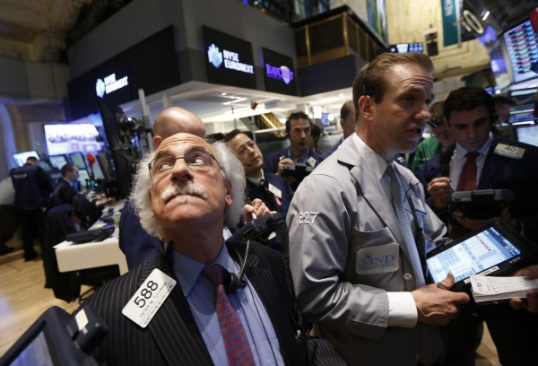 Traders work on the floor at the New York Stock Exchange, March 6, 2013.