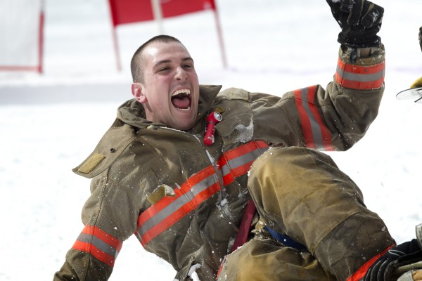 Kyle DeMillo of Jay Fire and Rescue, celebrates a strong run that put his team in the top three despite crashing at the finish line during the 23rd annual Firefighters Race at Sunday River Ski Resort, Sunday, March 24, 2013, in Newry.