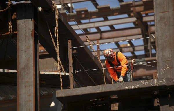 A construction worker performs labor at a residential building project in the China Basin area in San Francisco, Calif., on March 8, 2013. U.S. employers added a greater-than-expected 236,000 workers to their payrolls in February and the jobless rate fell to a four-year low, offering a bright signal on the economy's health.