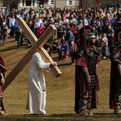 Man portraying Christ carrying his cross from Brewer to Bangor stops traffic as Catholics re-enact Way of the Cross