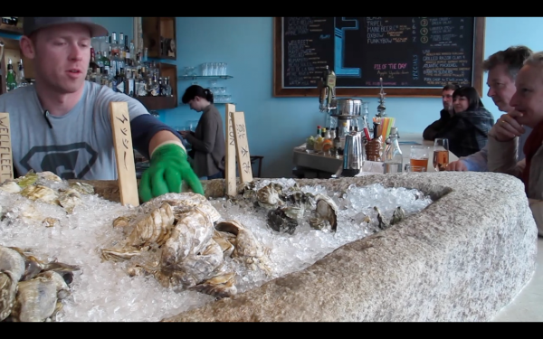Oysters stay cold on the 1200-pound Maine granite slab at Eventide Oyster Company in Portland.