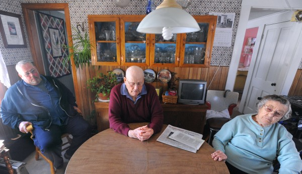 Douglas Millay (left) and his parents, George and Margaret Millay, sit together at the former Rocky Acres dairy farm in Liberty.  After the price of fuel, grain and other needed supplies jumped, they decided to close down the farm and sell the cows and equipment.
