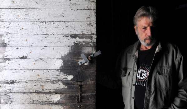 Alan Millay stands in the door of a barn that used to house dairy cows on Rocky Acres dairy farm in Liberty. After the prices of fuel, grain and other needed supplies jumped, Alan and his brother Douglas decided to close down the farm and sell the cows and the equipment. They first took over the farm from their parents in the 1980s.