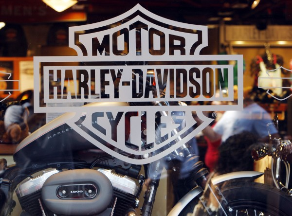 Motorcycle maker Harley Davidson's logo appears on the window of a store in Boston, Mass., in this 2008 file photograph. Harley Davidson recently banned music from being played in its factories.