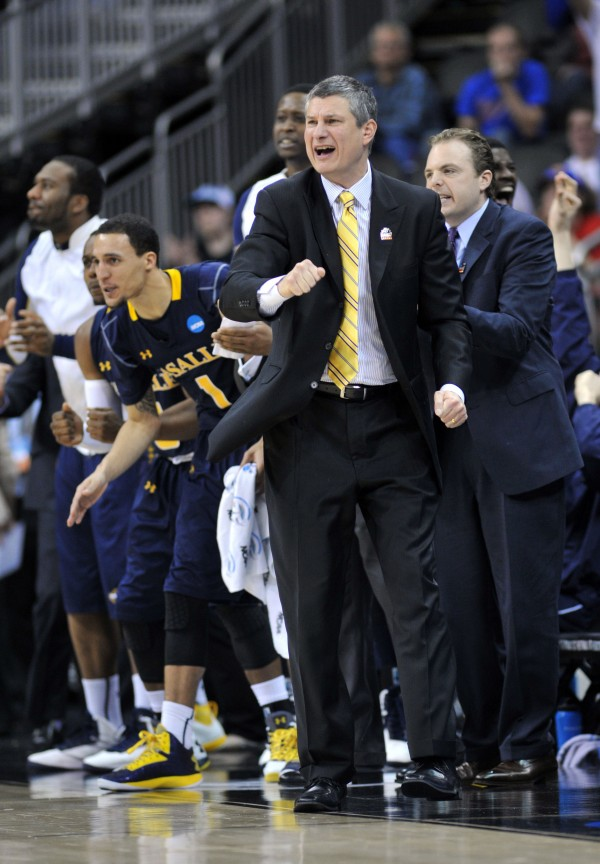 La Salle Explorers head coach Dr. John Giannini reacts after an Explorers score against the Mississippi Rebels in the second half during the third round of the NCAA basketball tournament at the Sprint Center. La Salle defeated Mississippi 76-74.
