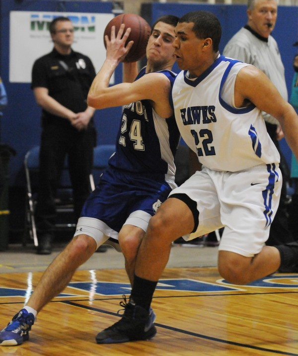 Easton's Jared Hafford drives to the basket with Hodgdon defender Joshua Hudson glued to his hip during an Eastern Maine Class D tourney game in February at the Bangor Auditorium. Hafford will play basketball next winter at the University of Maine-Fort Kent.