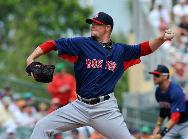 Boston Red Sox starting pitcher Jon Lester throws during a spring training game against the Miami Marlins on March 11 in Jupiter, Fla. The Red Sox are hoping for a bounce-back season from Lester after he struggled last season with a 9-14 record and 4.82 ERA.