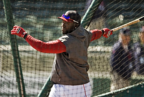 Boston Red Sox designated hitter David Ortiz takes batting practice during a workout before a spring training game on Wednesday with the Miami Marlins in Fort Myers, Fla. Ortiz will remain on the disabled list for Boston's opener on Monday and it's uncertain when he'll return.