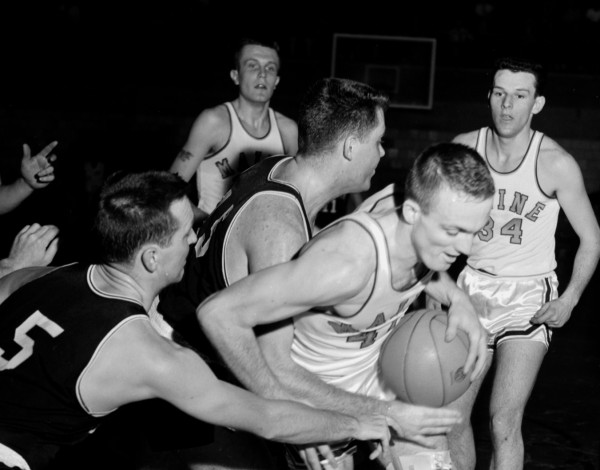 Maine's Don Sturgeon is stopped by Bowdoin's Bill Cohen (left) and Ed Callahan while Maine's Larry Schiner (left) and Skip Chappelle look on during a game in February 1961. Bowdoin and Maine were among the teams that competed in the Downeast Classic invitational college basketball tourneys at the Bangor Auditorium from 1959-60.