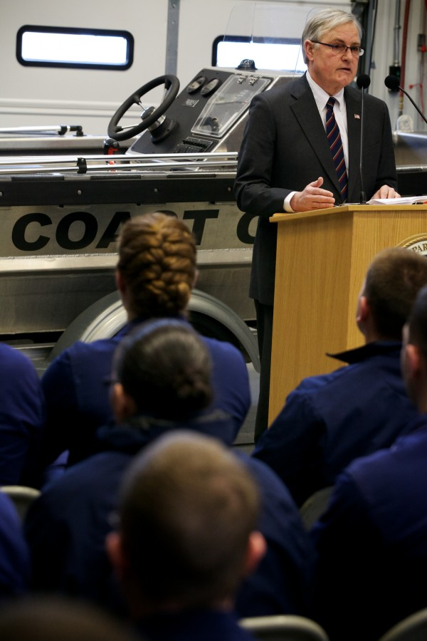 Retired Navy Vice Admiral Richard Mayo speaks at the South Portland Coast Guard station Thursday.
