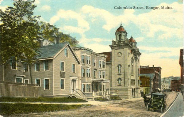 This postcard view of Columbia Street is postmarked 1914. Frank L. Peavey''s Livery Stable was located just beyond the Baptist Church on the left.