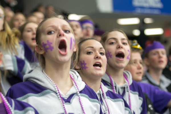 John Bapst fans Haley Hughes (left), Courtney Prue and Lauren Prue cheer during the second period of the the Eastern Maine Class B championship game against Messalonskee at Alfond Arena at the University of Maine in Orono on Tuesday, March 5, 2013.