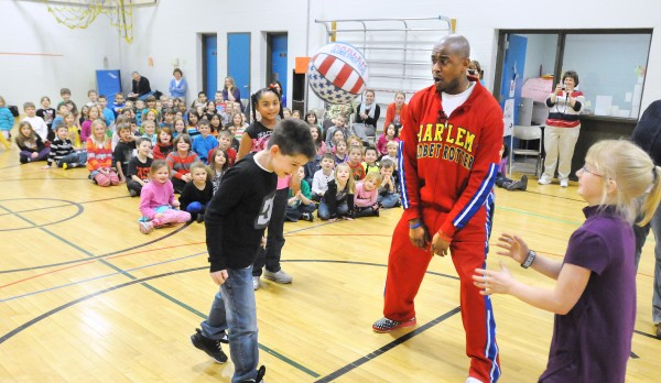 Harlem Globetrotter Scooter Christensen (second from right) teaches kids at the Abraham Lincoln School a Globetrotter trick after he spoke them them about bullying. Christensen is among the players who speak at schools about &quotThe ABCs of Bullying Prevention,&quot