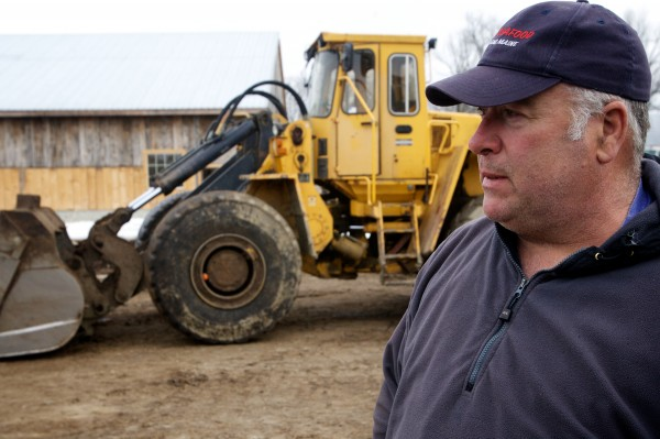 Eddie Benson uses a front end loader to mix and create certified organic compost on his dairy farm in Gorham.