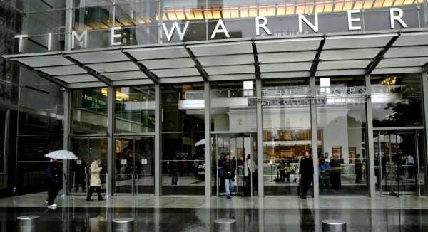 People walk in front of the Time Warner Inc. headquarters building in New York in this file photo. Time Warner said on Wednesday it plans to spin off Time Inc. into an independent, publicly traded company.