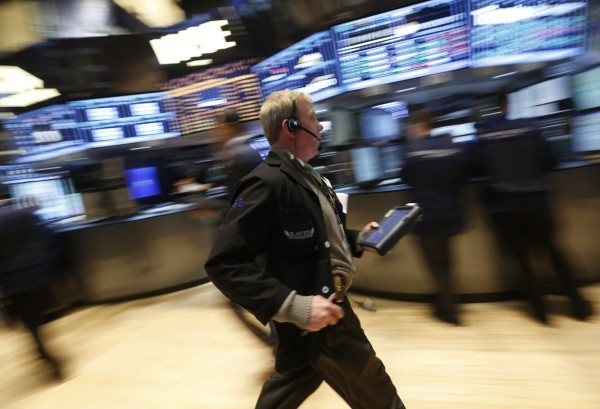 A trader rushes across the floor of the New York Stock Exchange on March 12, 2013.