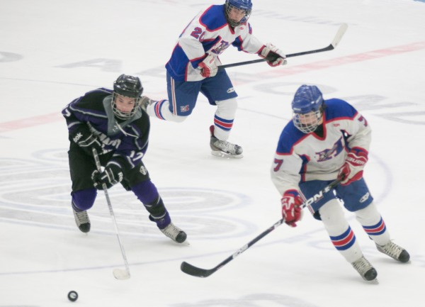 John Bapst forward Hunter Pate (left) chases the puck with Messalonskee forward Jacob Dexter (rght) while forward William Weeks (center) watches during the Eastern Maine Class B championship game at Alfond Arena at the University of Maine on Tuesday, March 5, 2013.