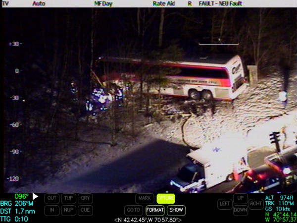 This photograph of the Tuesday, Feb. 26, 2013, accident night involving a Cyr Bus Lines motor coach carrying members of the University of Maine women's basketball team was taken from a Massachusetts State Police Air Wing helicopter. The driver of the bus, 55-year-old Jeff Hamlin of Charleston, was seriously injured in the crash. Several team members and a coach suffered minor injuries.