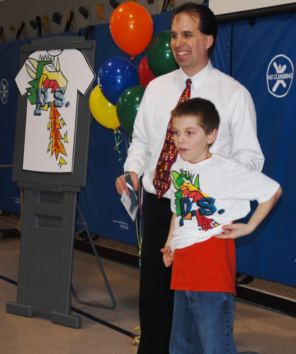 Wallagrass Elementary School third grader Austin Delisle shows off a T-shirt with his winning Aeropostale  design during a school assembly Wednesday. Delisle's design was the top entry among all third grade students nationwide.