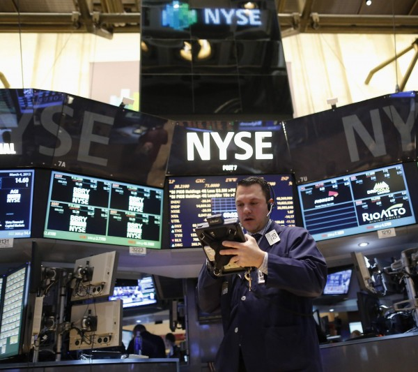 A trader works on the floor of the New York Stock Exchange on March 4, 2013.
