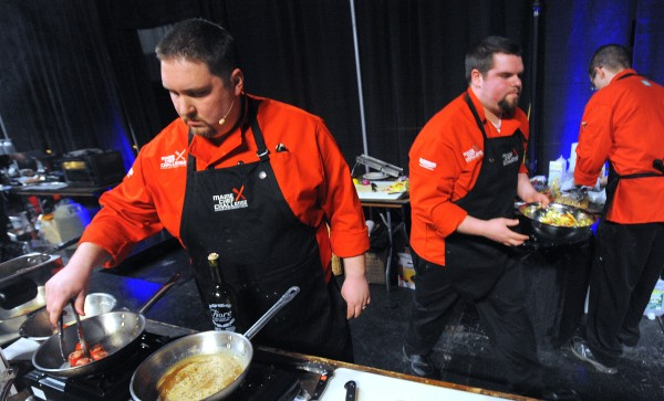 Red team chef Brandon Haney (left) and his teammates Evan Beaudry (center) and Ken Grover work on their first course during the second annual Maine Chef Challenge at Eastern Maine Community College in Bangor.