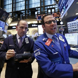 Wall Street climbs with health insurers, S&P nears high