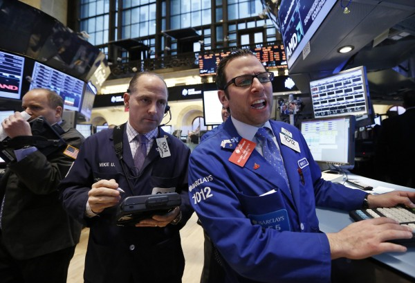 Traders work on the floor at the New York Stock Exchange on March 28, the day the S&P 500 closed at a record high.